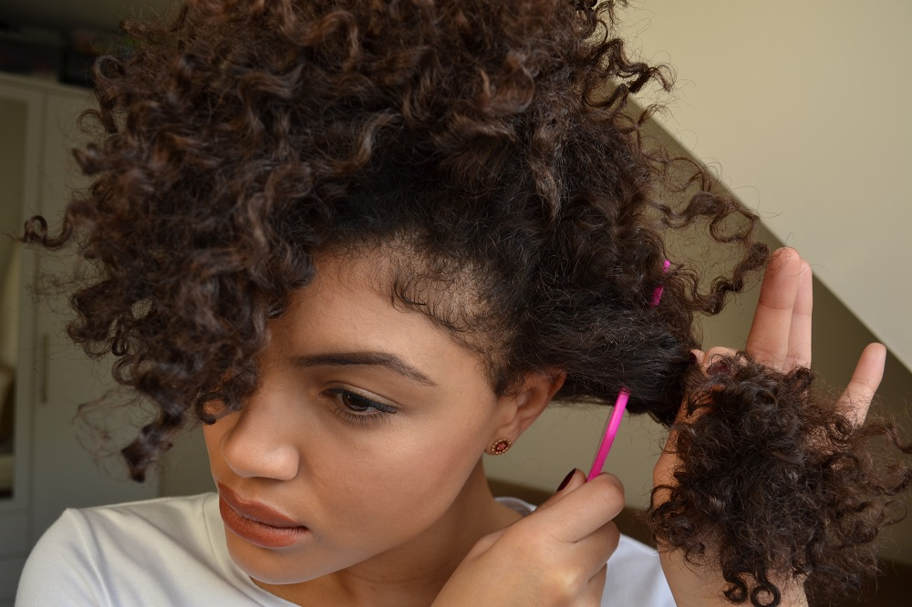 Afro combing curly hair