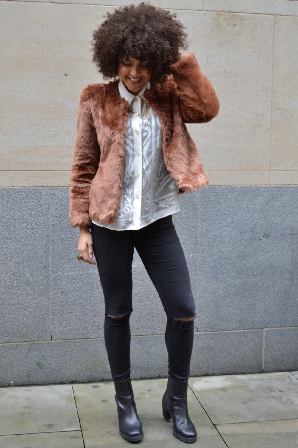 fur jacket, ripped jeans, boots