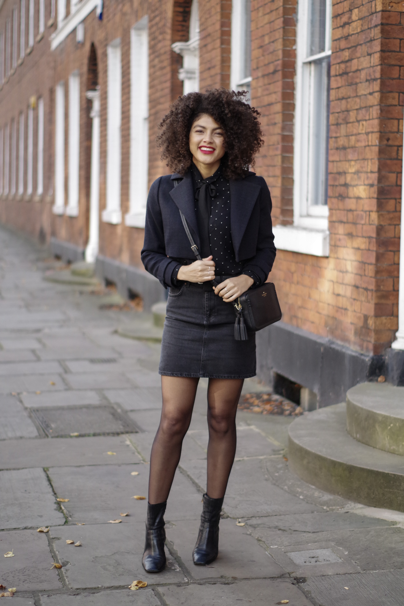 black denim asos skirt ankle boots kate spade cross body bad and cropped navy jacket outfit
