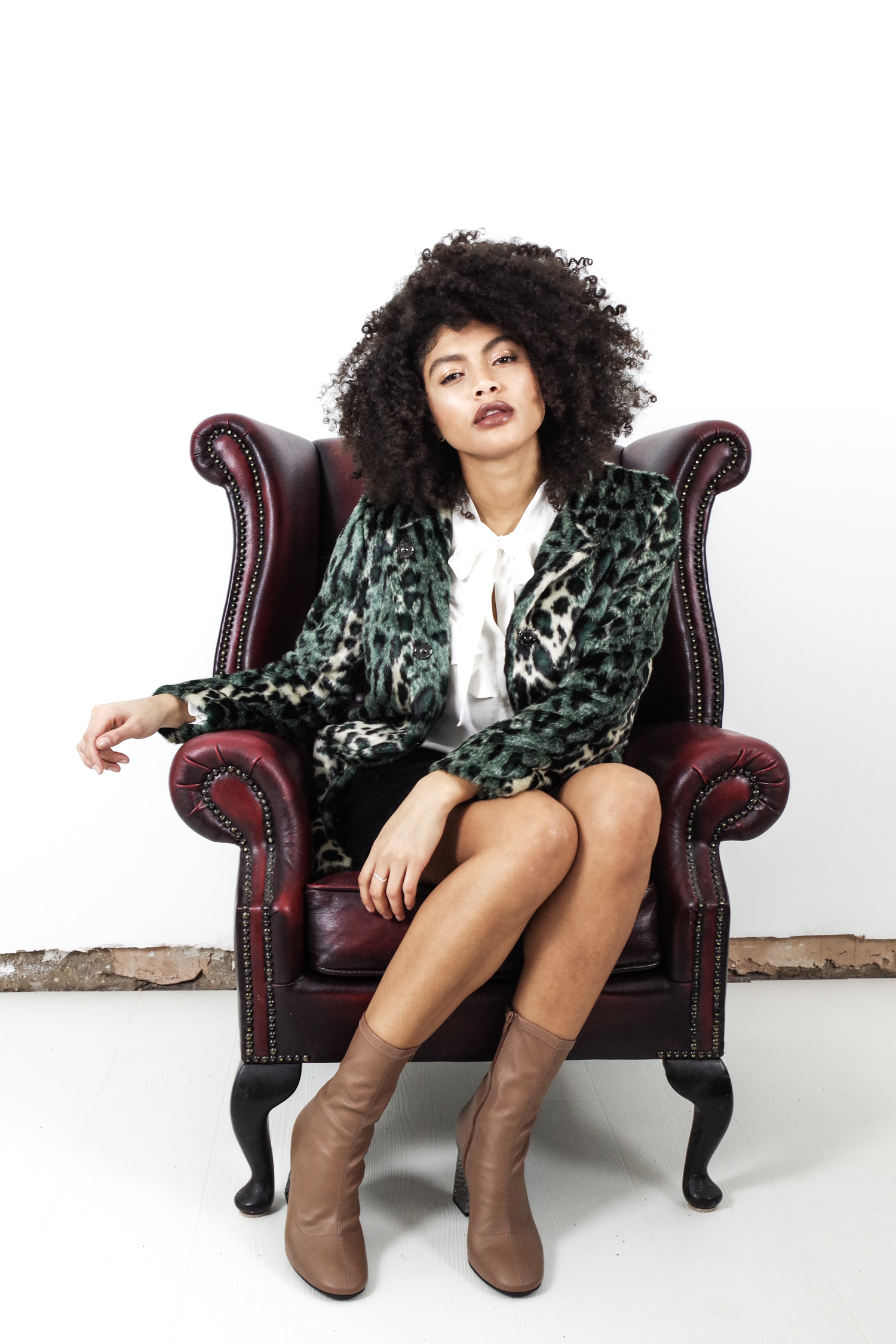 Faux fur coat and afro