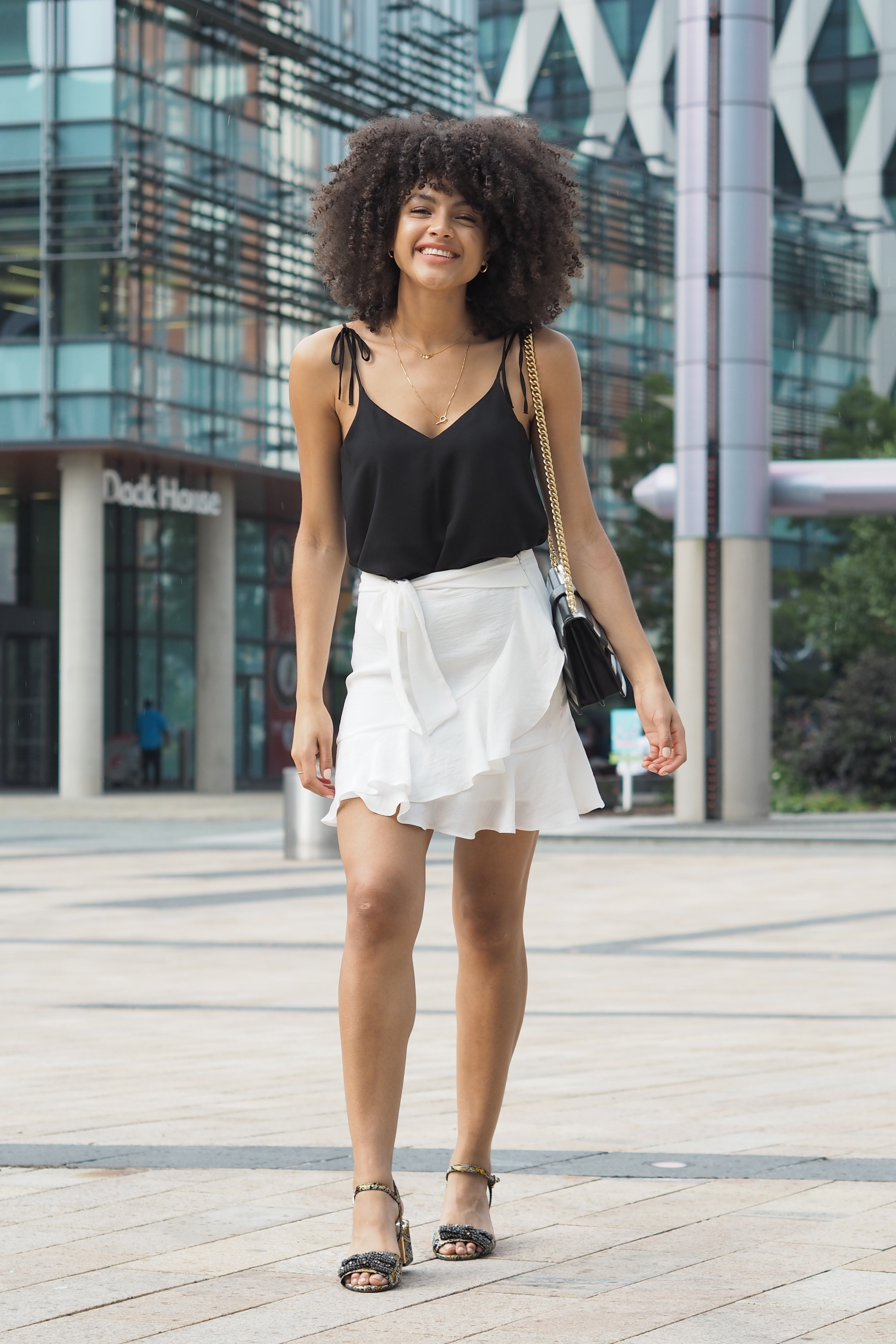 White Ruffle Mini Skirt and Black Cami Spring Summer Outfit