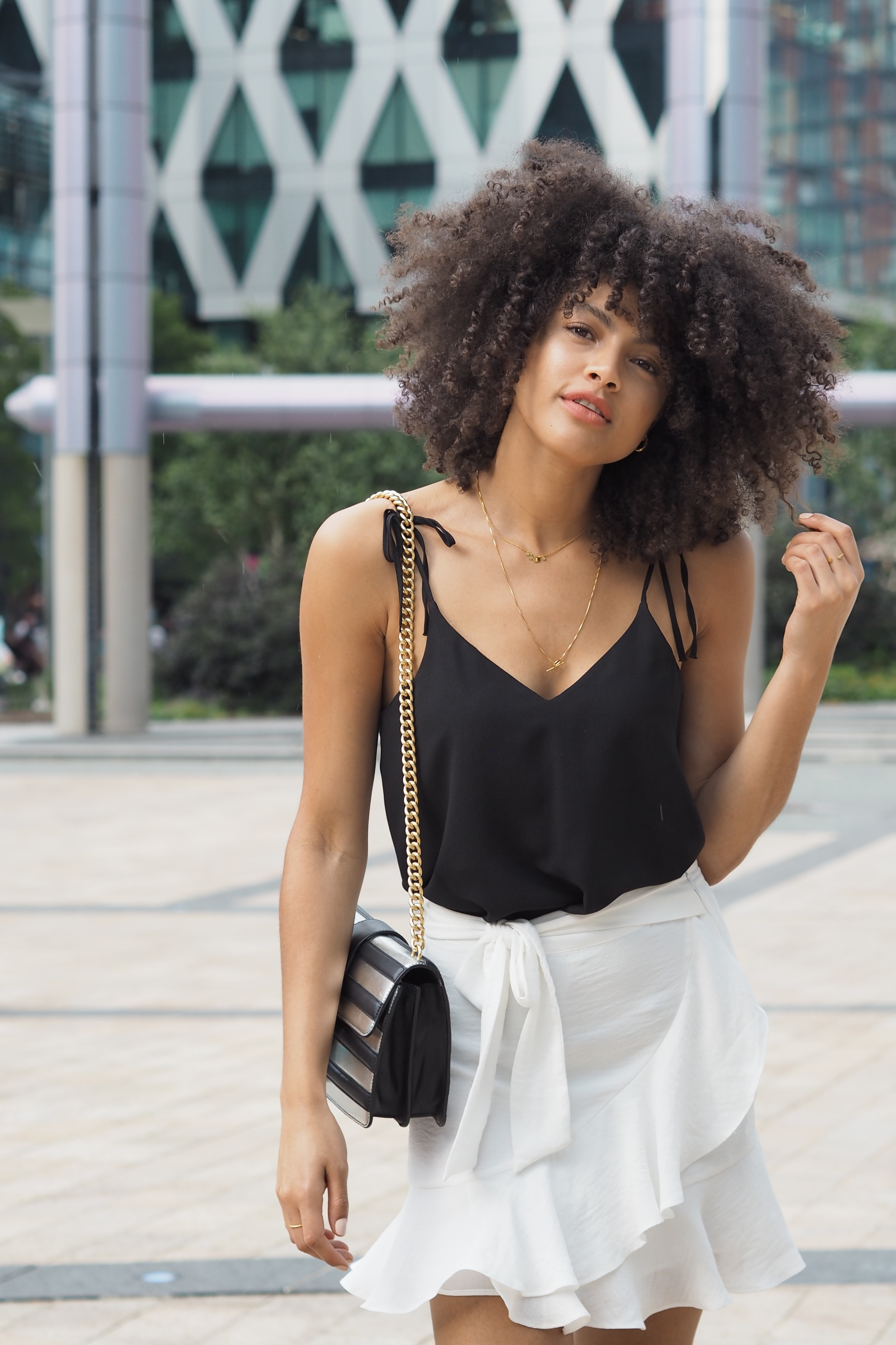 White Ruffle Mini Skirt and Black Cami Summer Outfit